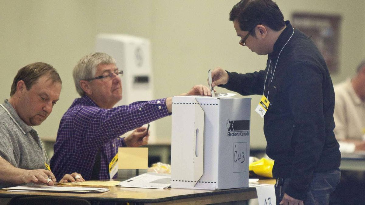 A voter casts his ballot in Calgary.