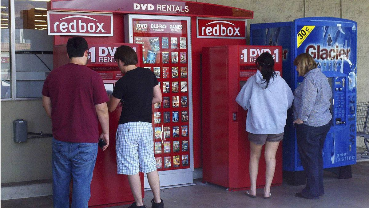 Customers rent DVD movies from a Redbox video kiosk in Burbank, Calif. in this May 8, 2011 file photo.