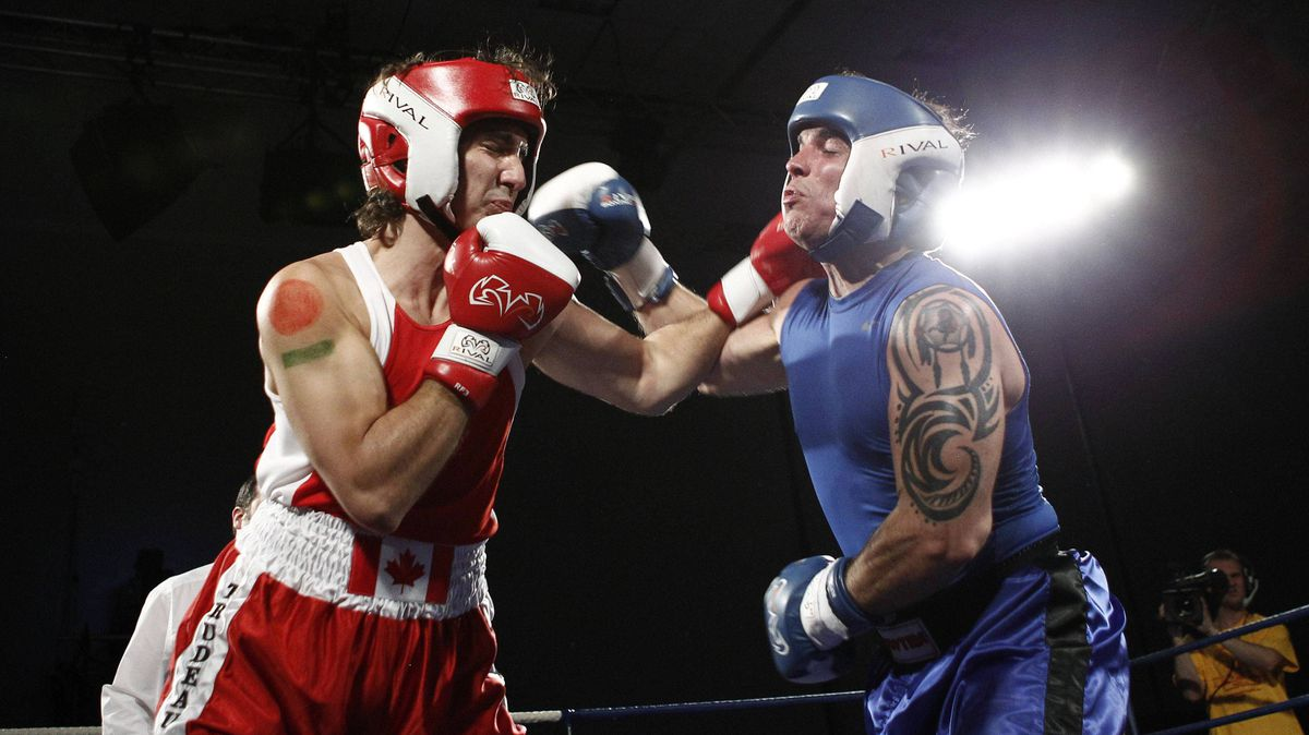 Liberal MP Justin Trudeau, left, engages in fisticuffs with Conservative Senator Patrick Brazeau in a charity match in Ottawa on Saturday night.