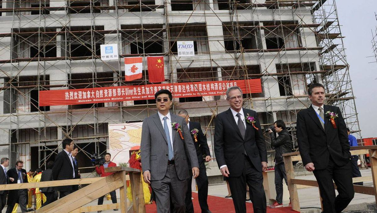 Natural Resources Minister Joe Oliver visits a construction site in the Tianjin Economic Development Area in Tianjin, China, Monday, Nov. 7, 2011.