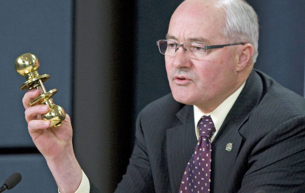 Liberal MP Wayne Easter holds up a doorknob during a news conference in Ottawa on October 19, 2009.