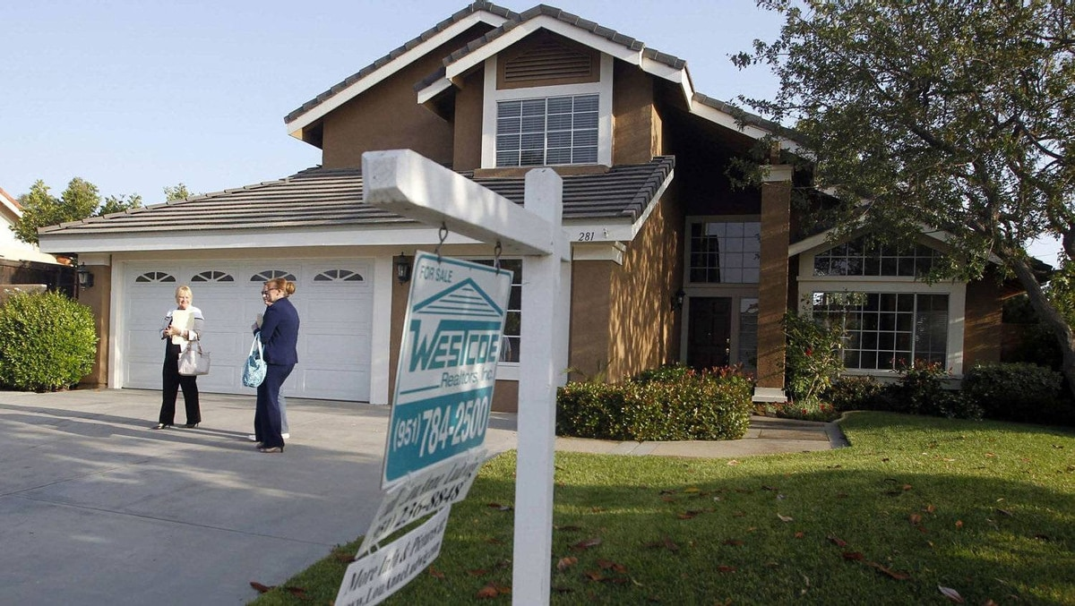 A real estate agent shows a home to prospective buyers last week in Riverside, Calif.,