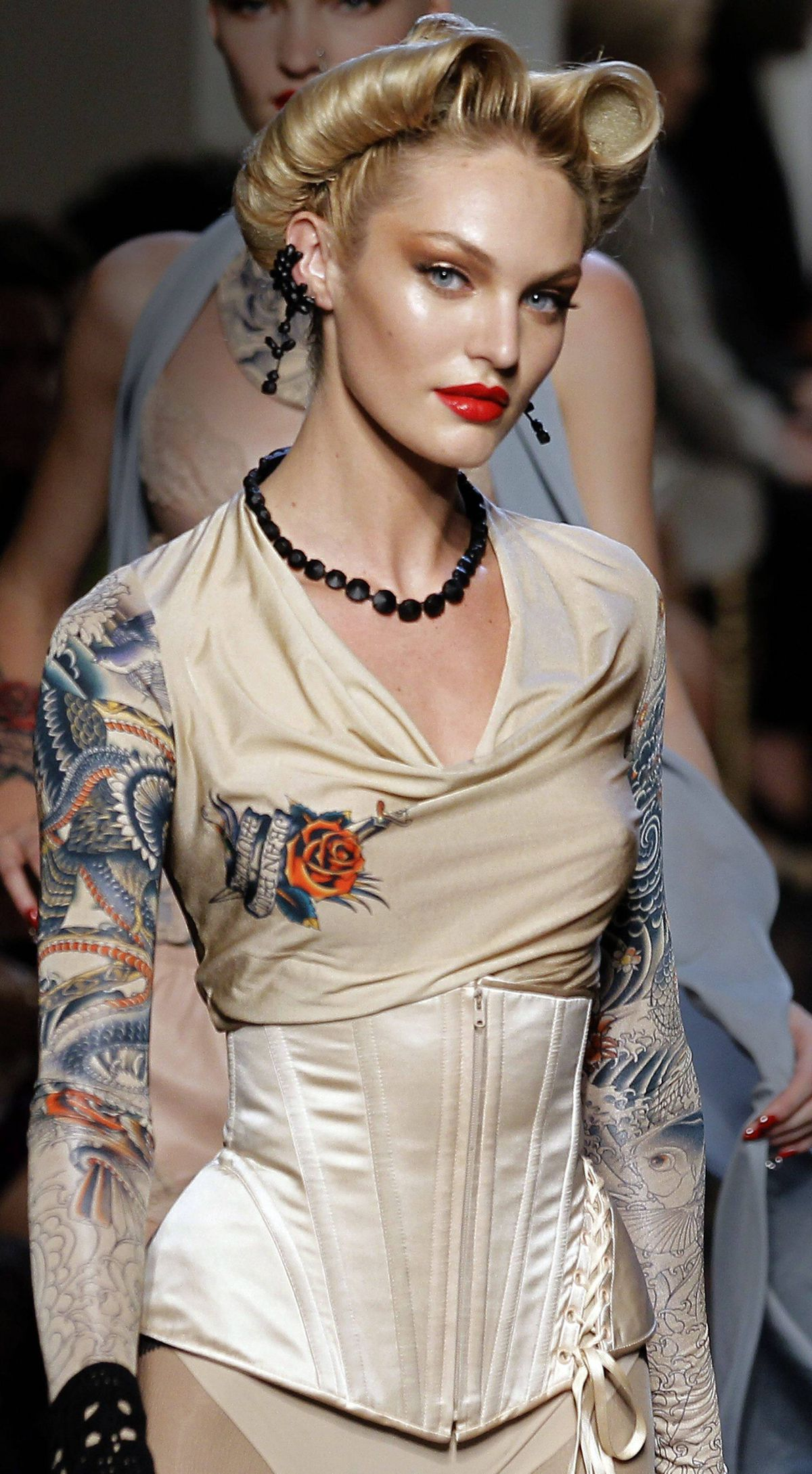 Sans music, the show was narrated by Charlotte Le Bon, who offered up distracting tidbits about each model like a bachelorette auction. But deconstructed shirts, trenches and corsets were evidence that Gaultier has not lost his touch – and the tattoo stuff was proof that he still mines the street for chic.