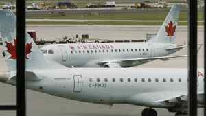 Air Canada planes sit on the tarmac at Pearson International Airport in Toronto.