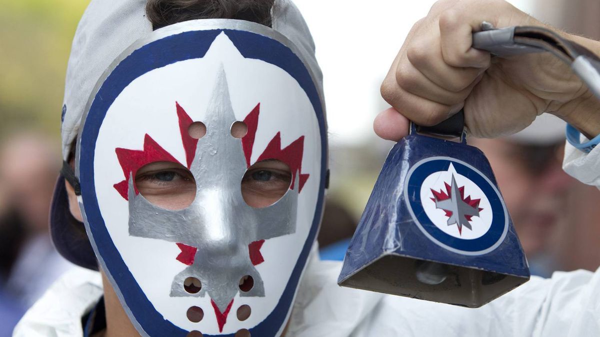 A Winnipeg Jets fan holds upa cowbell before the Jets inaugural game against the Montreal Canadiens at the MTS Centre in Winnipeg, Sunday, Oct. 9, 2011. THE CANADIAN PRESS/Jonathan Hayward