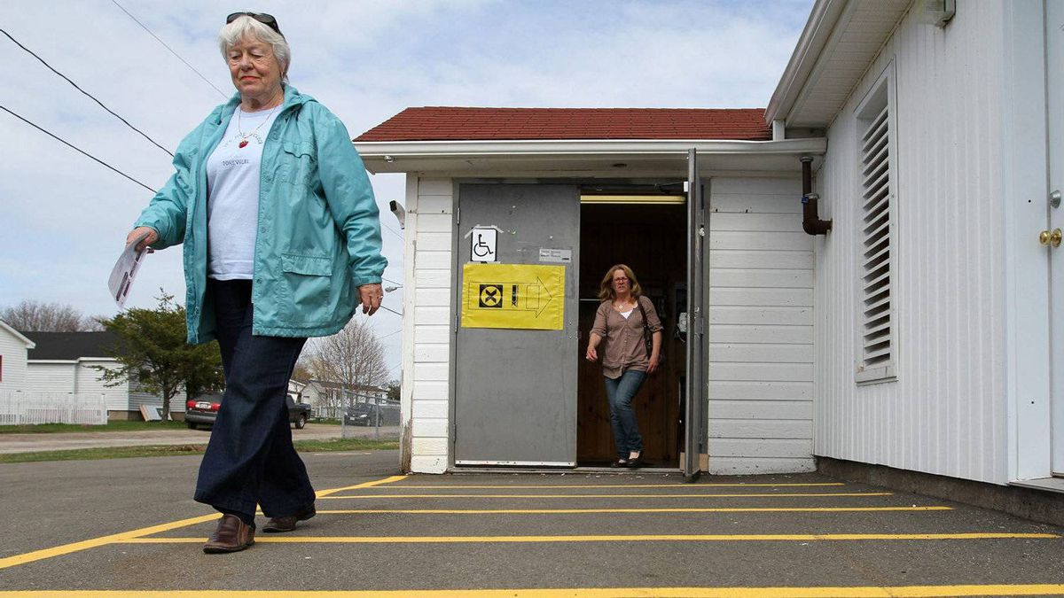 People leave a polling station in Point-du-Chene, New Brunswick as Canada goes to the polls for the federal election on Monday May 2, 2011.