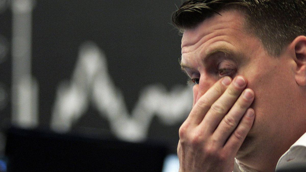 Stock trader Michael Pansegrau reacts at the German stock exchange in Frankfurt, central Germany, Friday, Aug. 5, 2011.