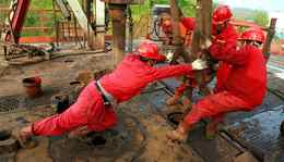Workers at a PetroChina oil field in Tongnan, southwest China's Sichuan province.