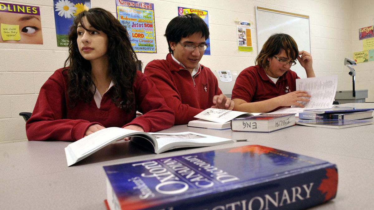 Evelyn Osorno, left, and siblings Gianmarco and Tixiana Ferrari, looks through language books at St. Marcellinus Secondary School in Mississauga, January 21, 2010.