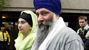 Ajaib Singh Bagri leaves B.C. Supreme Court in Vancouver, B.C. with his daughter after he was found not guilty in the bombing of an Air India flight 182 in 1985, Wednesday, March 16, 2005.