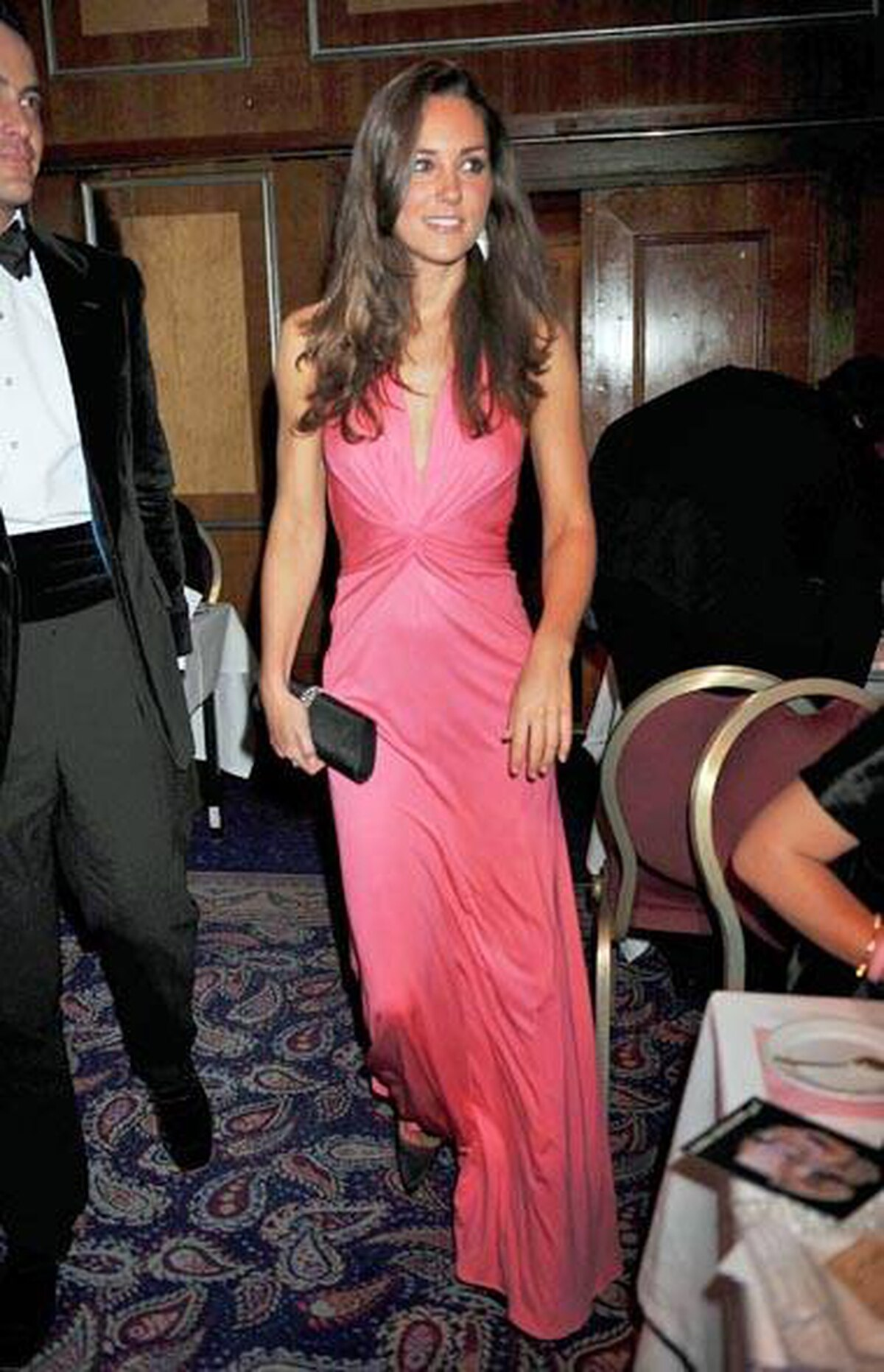 Her affinity for affordable finds at High Street shops such as Top Shop and Oasis suggests she's a princess of the people, but Ms. Middleton also scores top points for effortless eveningwear in a gown by London-based label Issa.
