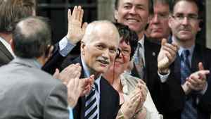 NDP Leader Jack Layton, who is recovering from hip surgery, acknowledges a standing ovation in the House of Commons on March 9, 2011.