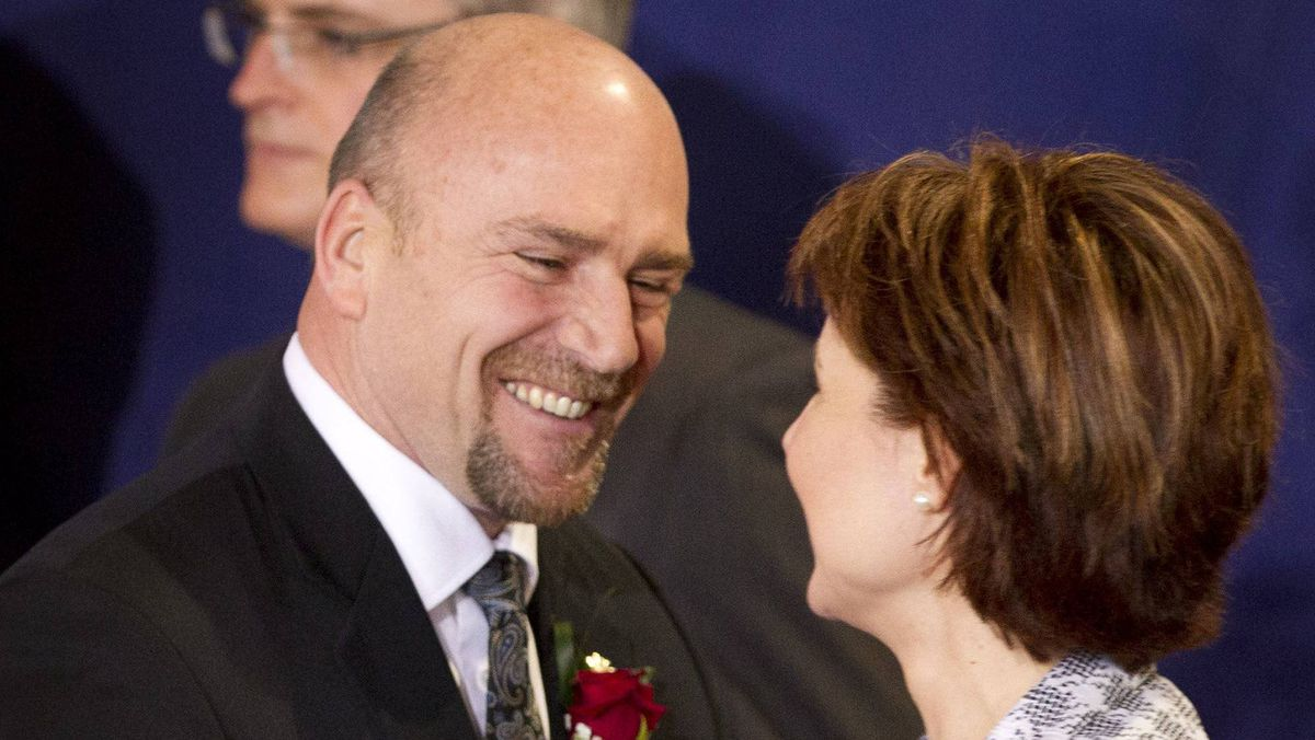 Transportation Minister Blair Lekstrom, shown with Premier Christy Clark, is being pressed by Lower Mainland mayors to impose a vehicle tax to help fund public transit.