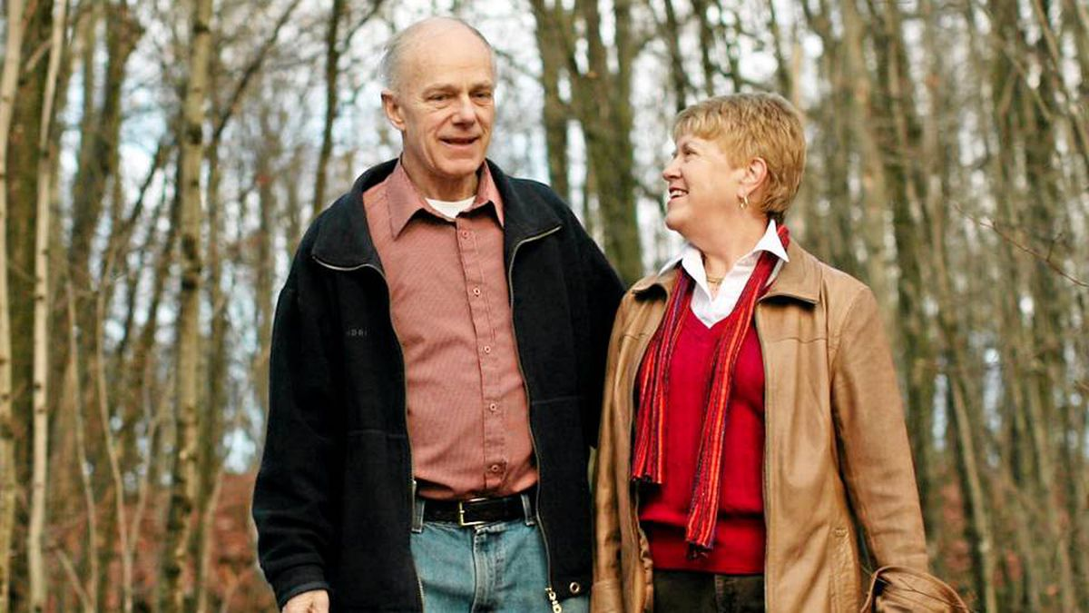 Ken Jamieson and his wife Brenda takes a walk at their home in Gatineau, Quebec. Ken was diagnosed with colon cancer late last year.