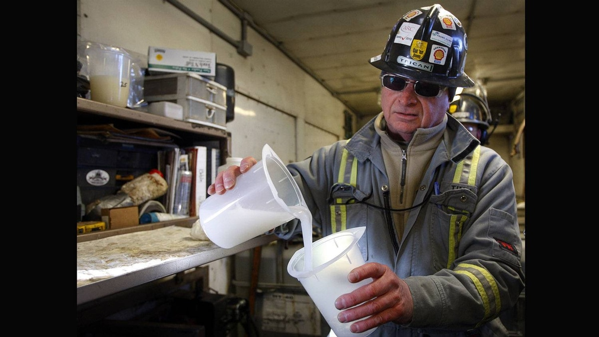 Tim Irons, a quality control technician, checks the state of fluid that will be pumped into the ground during the hydraulic fracturing process at an operation near Bowden, Alta., Tuesday, Feb. 14, 2012.