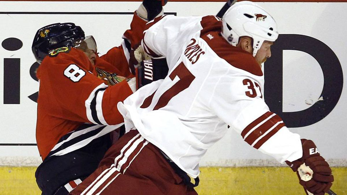 Chicago Blackhawks' Marian Hossa (L) is checked by Phoenix Coyotes' Raffi Torres during Game 3 of their NHL Western Conference quarter-final playoff hockey game in Chicago.