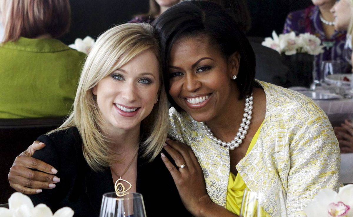 """U.S. first lady Obama hugs Canadian figure skater Rochette while attending a """"Women of Distinction"""" luncheon as part of the G20 Summit in Toronto"""