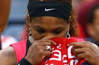 Serena Williams of the United States wipes her face during a break in play against Samantha Stosur of Australia during the Women's Singles Final on Day Fourteen of the 2011 US Open at the USTA Billie Jean King National Tennis Center on September 11, 2011 in the Flushing neighborhood of the Queens borough of New York City. (Photo by Clive Brunskill/Getty Images)