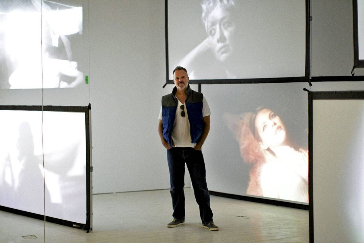 Barr Gilmore, designer of the Essential Cinema exhibition, stands in the midst of his exhibit at the Bell Lightbox.