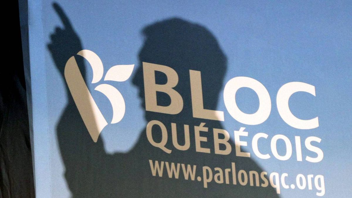 Bloc Quebecois Leader Gilles Duceppe casts a shadow on a campaign backdrop as he speaks to a rally at a CEGP de l'Outaouais in Gatineau, Que., on April 14, 2011.