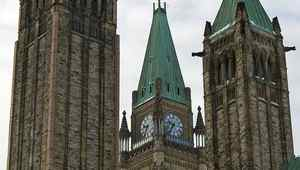 The Peace Tower sits between the towers of the Senate on Parliament Hill in January of 2011.
