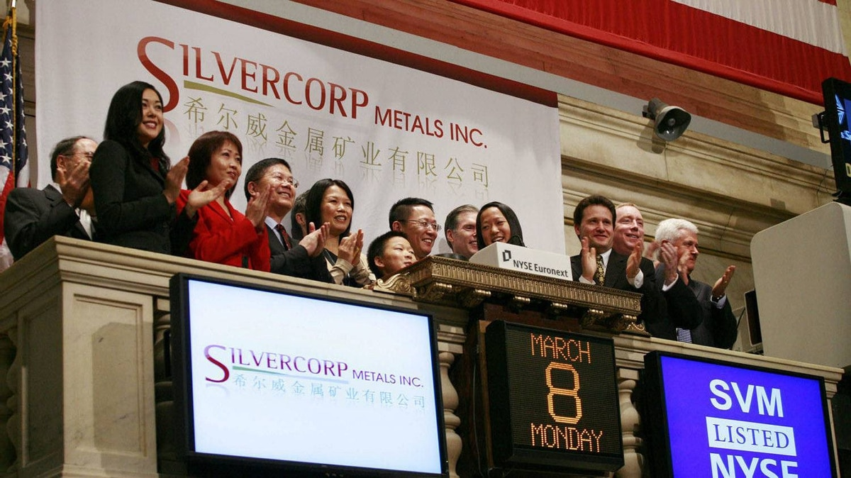 Employees and guests of Silvercorp Metals attend the opening bell at the New York Stock Exchange, Monday, March 8, 2010.