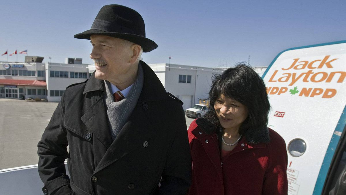 NDP leader Jack Layton and his wife Olivia Chow stand on the steps of the campaign plane as he heads out in Ottawa on Saturday, March 26, 2011.