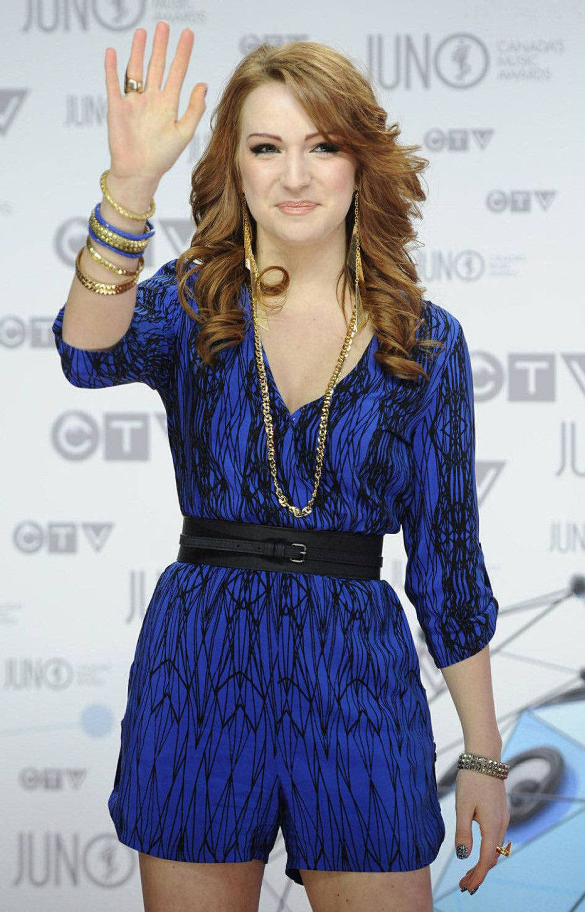 Victoria Duffield waves as she poses for photographers on the red carpet at the Juno Awards in Ottawa, Sunday April 1, 2012.