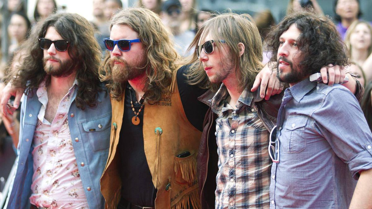 The Sheepdogs pose for photographs on the red carpet during the 2011 MuchMusic Video Awards in Toronto on Sunday, June 19, 2011.