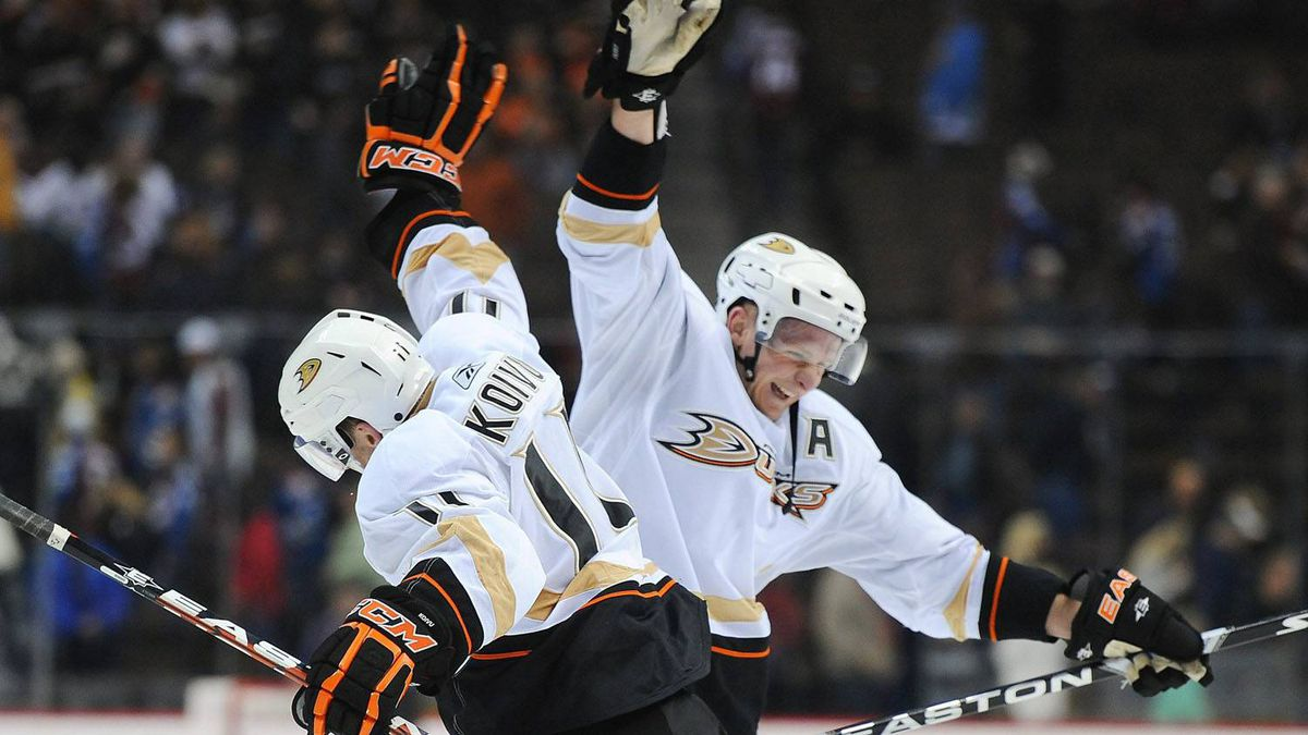 Anaheim Ducks center Saku Koivu, left, of Finland, congratulates right wing Corey Perry, right, after a hat trick by Perry to win an NHL hockey game against the Colorado Avalanche, Saturday, Feb. 5, 2011, in Denver . The Ducks won 3-0. (AP Photo/Chris Schneider)