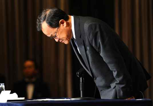 Olympus Corp. president Shuichi Takayama bows in apology during a press conference in Tokyo Tuesday, Nov. 8, 2011. Olympus admitted Tuesday that it used a series of acquisitions to hide massive losses, reversing earlier denials of any wrongdoing.