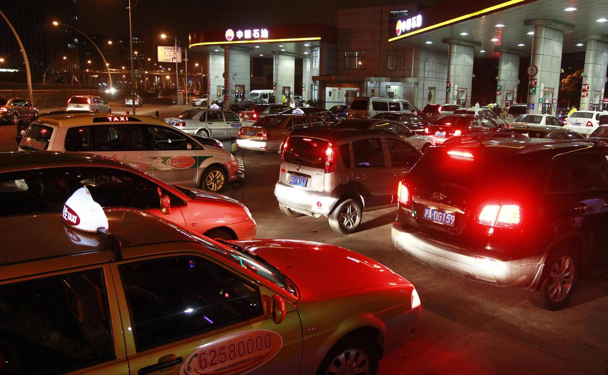 Vehicles wait at a gas station in Shanghai