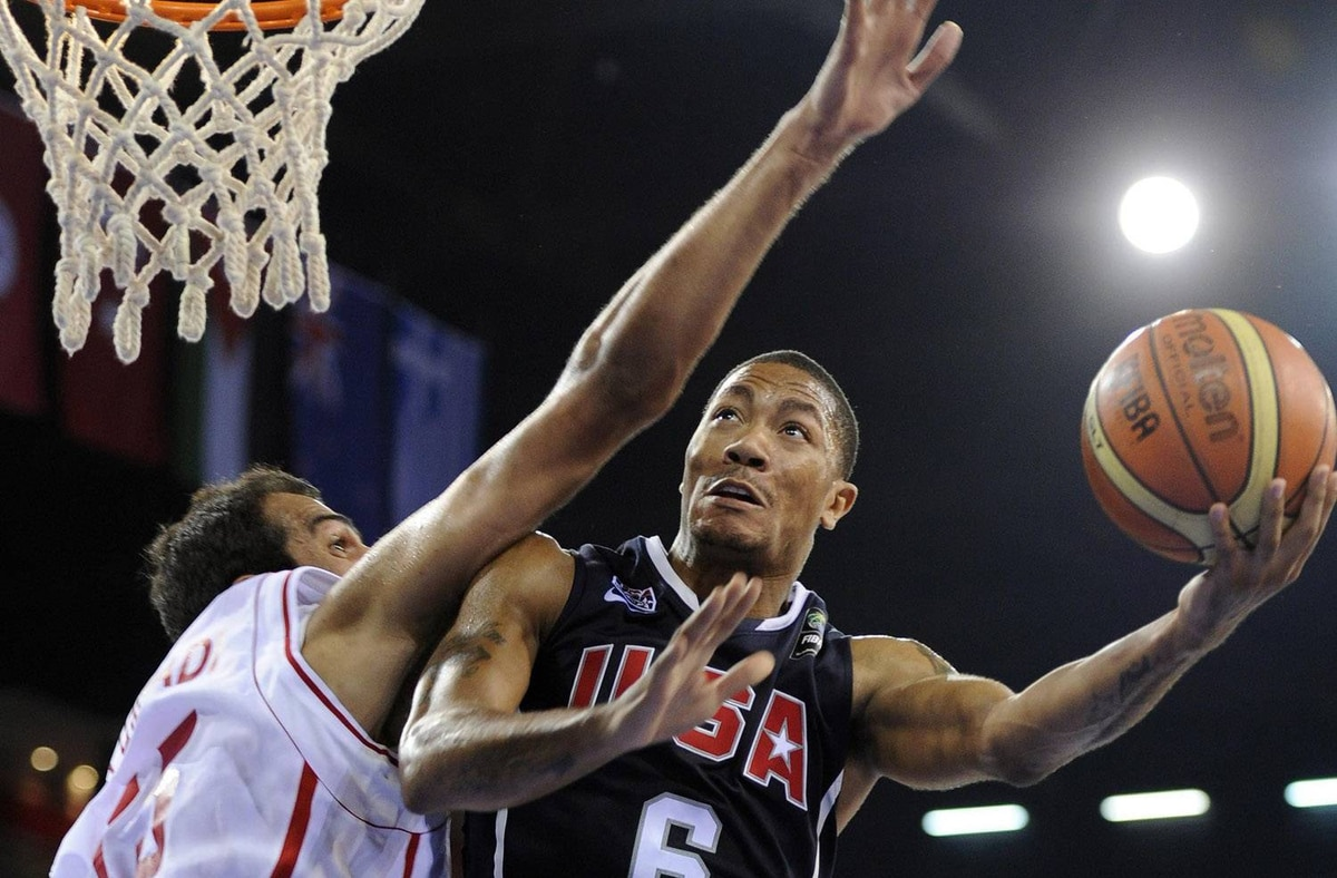 USA's Derrick Rose, right, goes up for a shot as Iran's Hamed Ehadadi defends during the preliminary round of the World Basketball Championship, Wednesday, Sept. 1, 2010, in Istanbul, Turkey. (AP Photo/Mark J. Terrill