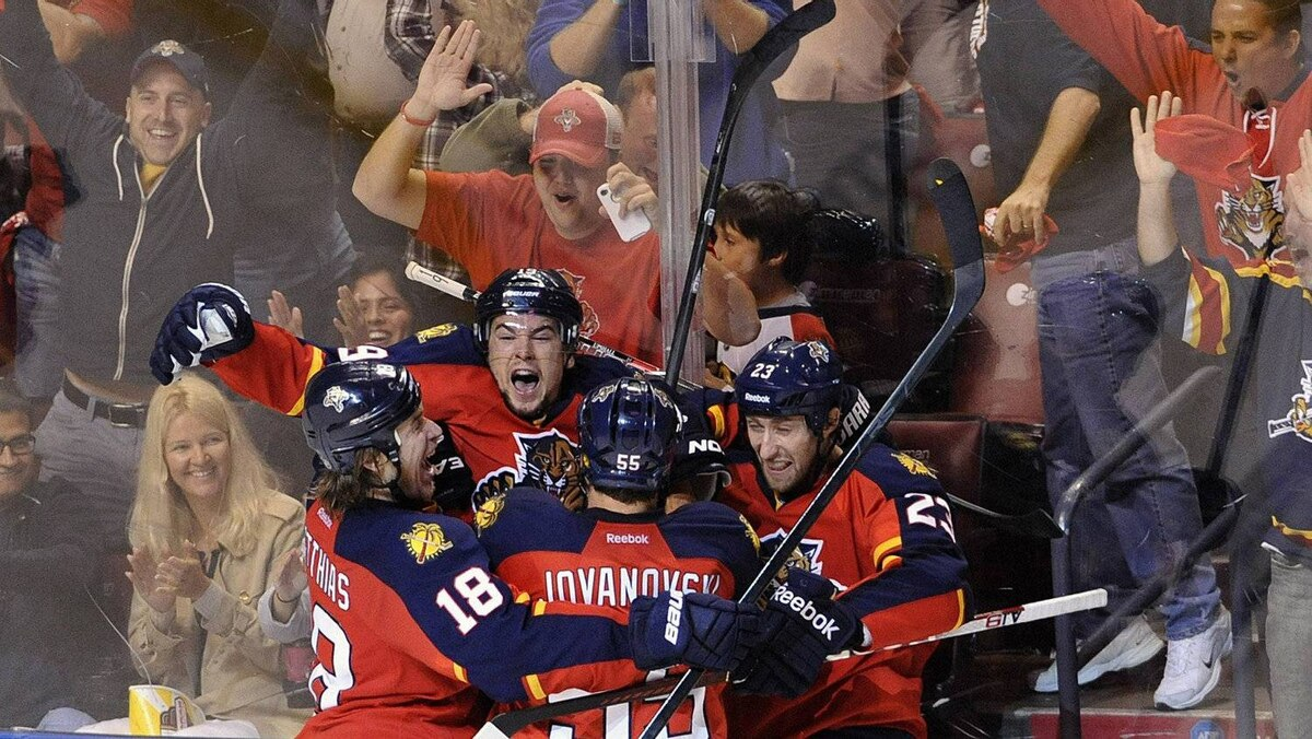Florida Panthers' Scottie Upshall (top) celebrates his goal against the New Jersey Devils with his teammates during the third period of their NHL Eastern conference quarterfinal playoff hockey Game 5 in Sunrise, Florida April 21, 2012.