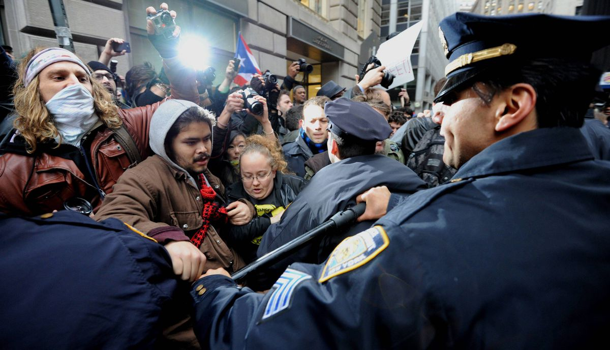 New York Police Department officers push back people as demonstrators with 'Occupy Wall Street' mark the two month anniversary of the protest November 17, 2011 in New York.