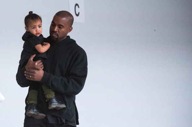 72babf3f1c08b Kanye West carries his daughter