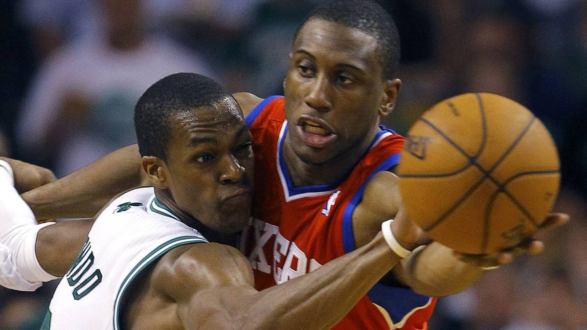 Boston Celtics' Rajon Rondo (L) and Philadelphia 76ers' Thaddeus Young battle for the ball during the third quarter. REUTERS/Brian Snyder