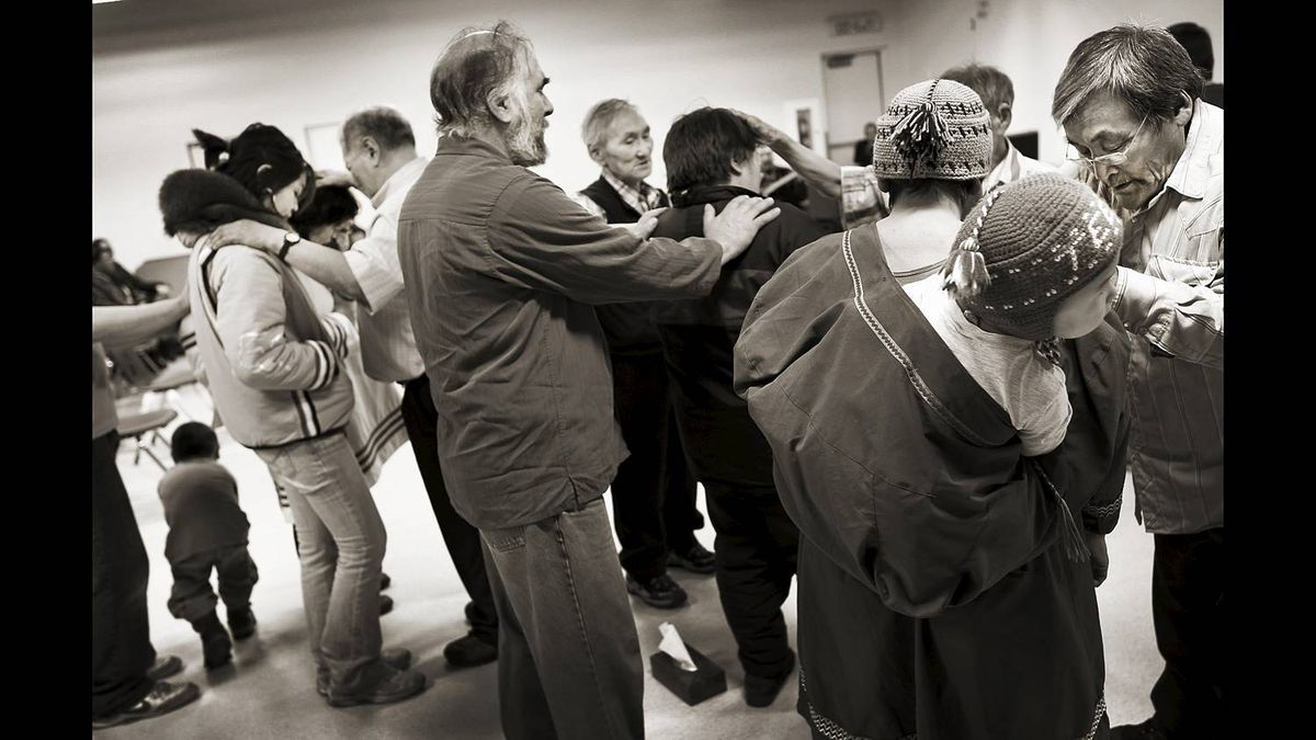 "In keeping with tradition, most Inuit refuse to speak frankly about violent incidents in their communities, and refer to them only in broad terms as ""the troubles."" But with a renewed sense of urgency a men's group has evolved and is working within communities to hold healing services, like this one in Repulse Bay, Nunavut on November 13, 2010."