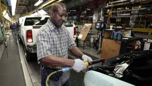 General Motors auto assembly worker Dwight Brown assembles pickup trucks at the Flint Assembly in Flint, Michigan in this January 24, 2011 file photo.