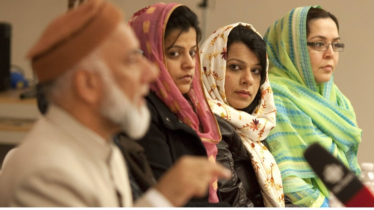 Nurgus Moghal, middle left, Nighat Amir, middle right, and Farina Siddiqui listen to Imam Syed B. Soharwardy in Mississauga on Saturday, as Muslim leaders across Canada and the United States denounced so-called honour killings in the wake of the Shafia murder trial.