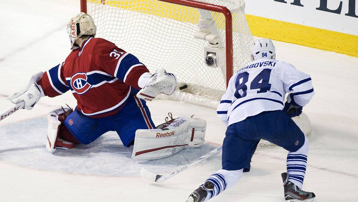 Toronto Maple Leafs' Mikhail Grabovski (84) scores against Montreal Canadiens goaltender Carey Price during third period NHL hockey action in Montreal, Saturday, March 3, 2012. THE CANADIAN PRESS/Graham Hughes