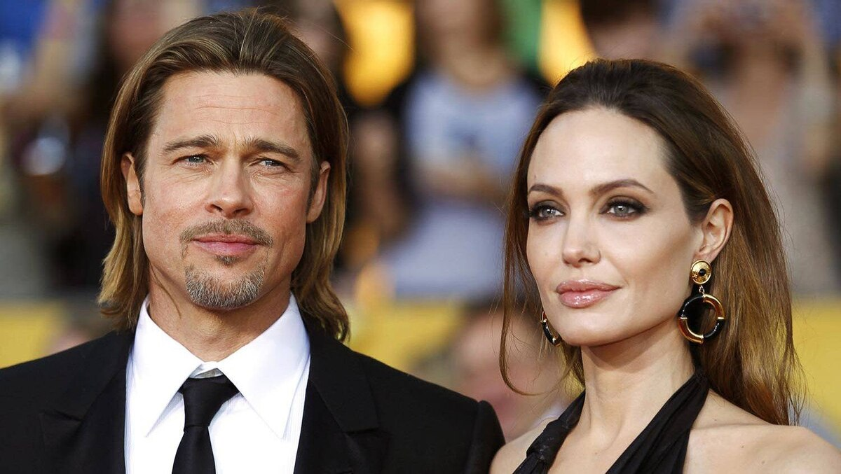 "Actor Brad Pitt from ""Moneyball"" and actress Angelina Jolie pose on arrival at the 18th annual Screen Actors Guild Awards in Los Angeles, California January 29, 2012."