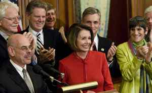 House Democrats clap for Speaker of the House Nancy Pelosi (D-CA) during a press conference after a vote on health care on Capitol Hill November 7, 2009 in Washington, DC. The House of Representatives passed the healthcare reform bill 220 to 215 after a late-night vote.