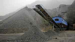 Ore is piled up for delivery at a mine owned by Silvercorp Metals Inc. in Jiyuan, China, on Sept. 27, 2011. A mining analyst believes Silver Standard Resources could be worth as much as $58.