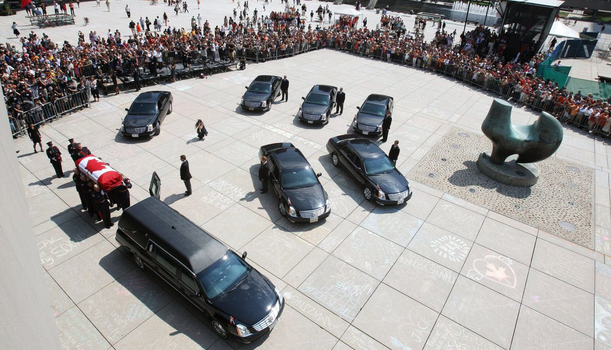 The casket of the late NDP leader Jack Layton is carried for transport to his funeral.
