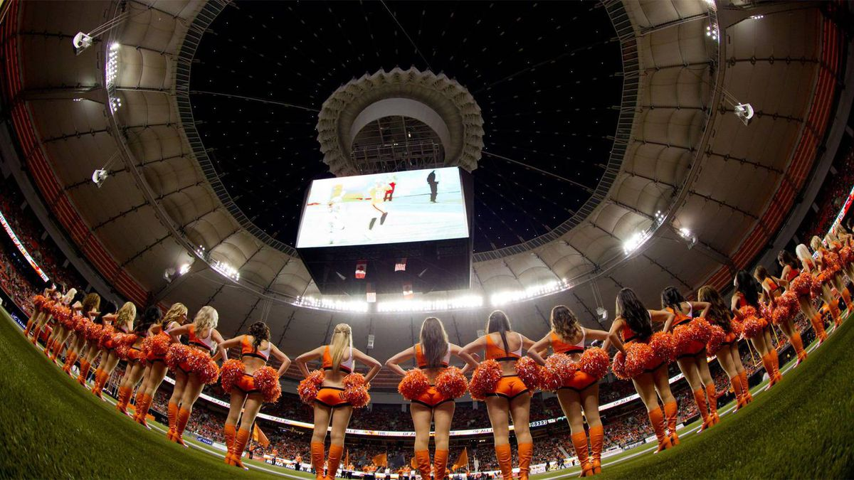 B.C Lions' cheerleaders line the field after the roof was opened at the renovated B.C. Place stadium before the B.C. Lions and Edmonton Eskimos CFL football game in Vancouver, B.C., on Friday September 30, 2011.