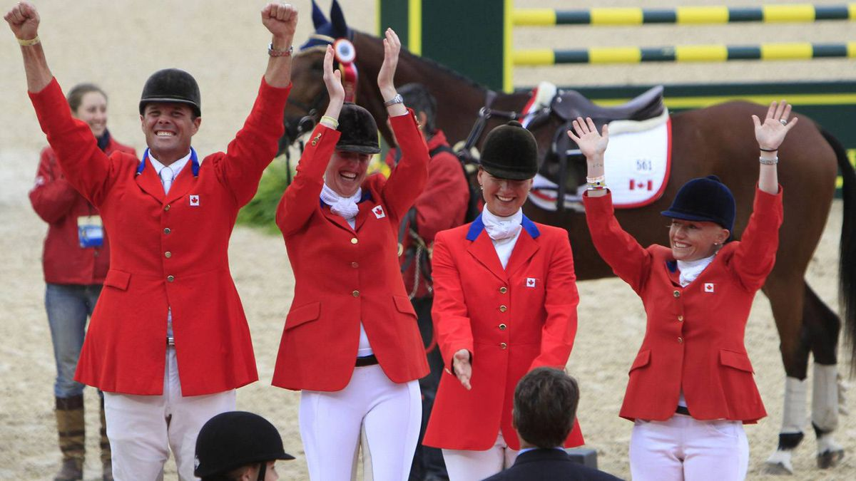 Canada's Eventing team (L to R) Kyle Carter, Selena O'Hanlon, Stephanie Rhodes-Bosch and Haeley Bennett-Awad celebrate after winning the team silver medal in the Eventing World Championship at the World Equestrian Games in Lexington, Kentucky, October 3, 2010.