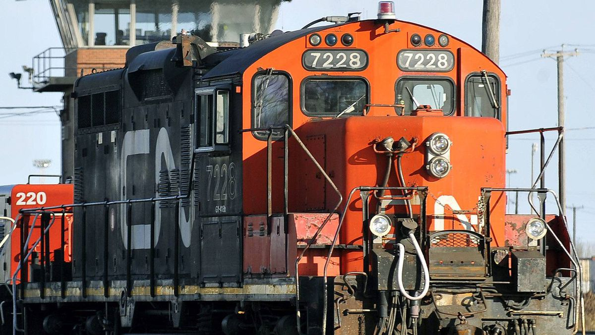 A CN locomotive makes it's way through the CN Taschereau yard in Montreal, Saturday, Nov., 28, 2009.
