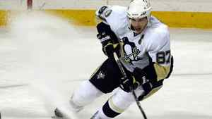 Pittsburgh Penguins center Sidney Crosby stops to stick-handle a loose puck during the first period of an NHL hockey game against the Buffalo Sabres in Buffalo, N.Y., on Wednesday, Nov. 24, 2010.