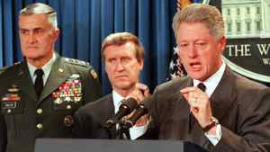 U.S. President Bill Clinton speaks during a 1998 press conference at the White House in Washington with Chairman of the Joint Chiefs of Staff, General Hugh Shelton, and Secretary of Defense William Cohen. AFP